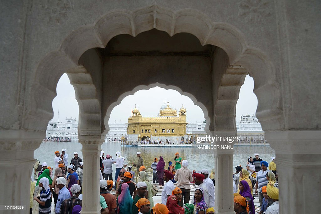 An Indian Sikh devotees prepare to pay their respects on the occasion Miri Piri Divas at the Sikh Shrine Golden temple in Amritsar on July 21, 2013. Miri Piri, Miri or temporal authority and Piri or spiritual authority, was highlighted by the sixth Sikh Guru, Guru Hargobind, when he was throned Guru on June 11, 1606.