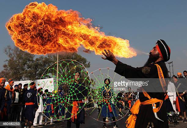 An Indian Sikh Nihang warrior performs a firebreathing act during 'Nagar Kirtan' a religious procession in Jammu on January 4 part of 'Prakash Utsav'...