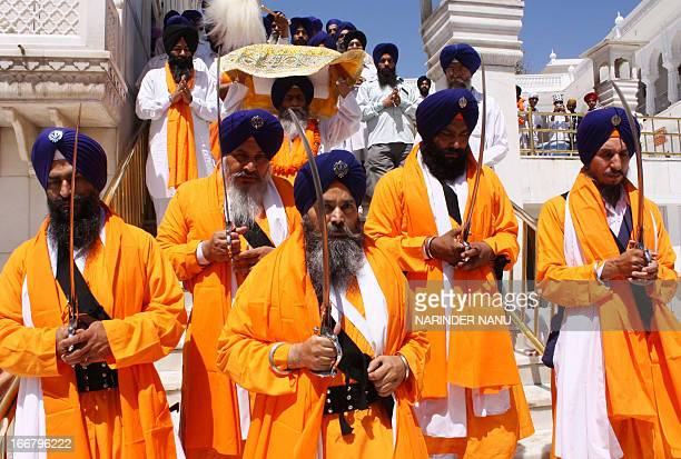 An Indian Sikh priest carries the Sikh holy book during a procession from the Sri Akal Takhat at the Sikh Shrine to the Golden Temple in Amritsar on...