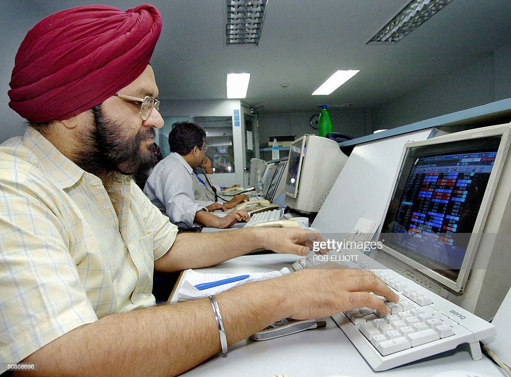 An Indian Sikh stock dealer checks a monitor at a brokerage house in Bombay, 20 May 2004, after stocks opened for the day, up 1.35 percent. Indian share prices eased after incoming prime minister Manmohan Singh said his leftist-backed Congress government would not sell profit-making public sector companies like oil giant ONGC and the state-run banks. AFP PHOTO/Rob ELLIOTT