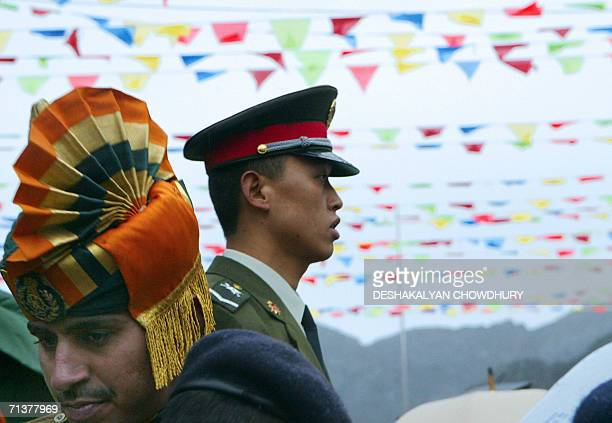 An Indian soldier and his Chinese counterpart prepare to take part in a ceremony marking the reopening of the ChinaIndia border at the 15000feet...