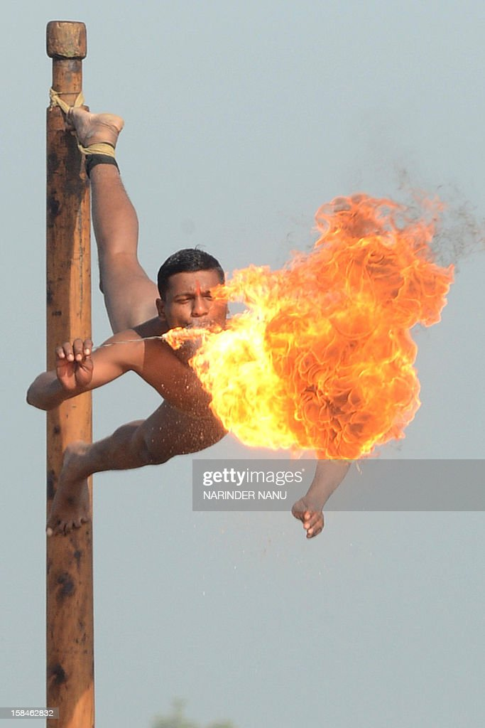 An Indian soldier blows fire as he performs the mallakhamb during an Army Mela (fair) and exhibition at Khasa, some 15 kms from Amritsar, on December 17, 2012. The Army Mela (fair ), organised by the Vajra Corps, displayed weapons, tanks, aircraft and military equipment to students and civilian visitors of the event.