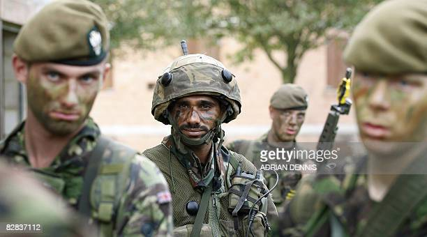 An Indian soldier listens to instructions from an officer beside his British counterparts during a joint training exercise with the British army at...