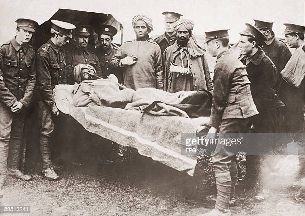 An Indian soldier serving with the British Army is stretchered to hospital during World War I circa 1916