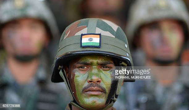 An Indian soldier sits with People's Liberation Army of China soldiers after participating in an antiterror drill during the Sixth IndiaChina Joint...