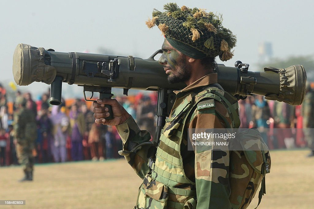 An Indian soldier stands with a Carl Gustav recoilless rifle during an Army Mela (fair) and exhibition at Khasa, some 15 kms from Amritsar, on December 17, 2012. The Army Mela (fair ), organised by the Vajra Corps, displayed weapons, tanks, aircraft and military equipment to students and civilian visitors of the event. AFP PHOTO/ NARINDER NANU