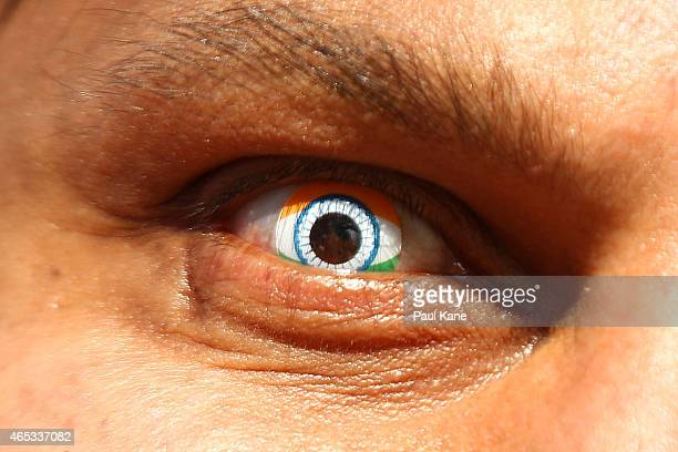 An Indian spectator shows his support by wearing Indian flag contact lenses during the 2015 ICC Cricket World Cup match between India and the West...