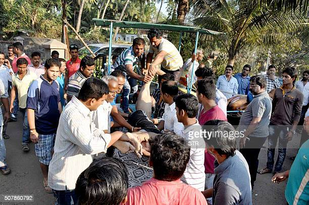 An Indian student drowning victim is placed on a stretcher near a beach in Murad in Maharashtra state on February 1 2016 Thirteen Indian students...