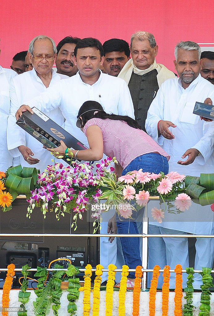 An Indian student seeks blessings after receiving laptop from the chief minister of Utar Pradesh, Akhilesh Yadav, during a laptop distribution function in Allahabad on October 6, 2013. Yadav is a member of the socialist leaning Samajwadi Party.