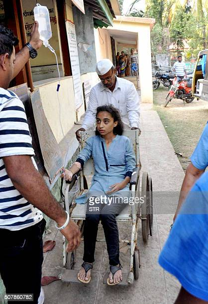 An Indian student sits in a wheelchair at a hospital in Murad in Maharashtra state after thirteen students drowned at a nearby beach on February 1...