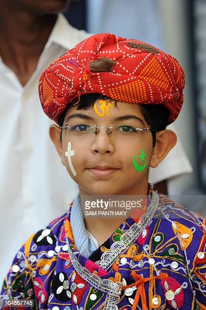 An Indian student takes part in India's 'Unity in Diversity' to spread the message of peace in Ahmedabad on September 30 2010 ahead of the Ayodhya...