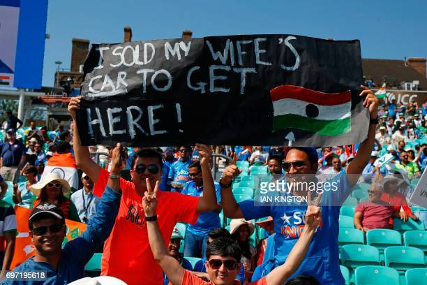 TOPSHOT An Indian supporter holds up a banner in the crowd ahead of the ICC Champions Trophy final cricket match between India and Pakistan at The...