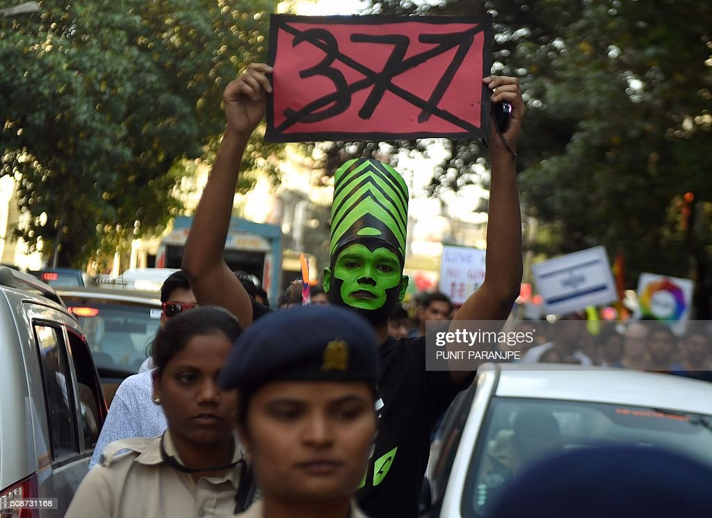 An Indian supporter of the lesbian, gay, bisexual and transgender community holds a placard during a Pride March in Mumbai on February 6, 2016. India's top court agreed to review a decision which criminalises gay sex, sparking hope among campaigners that the colonial-era law will eventually be overturned in the world's biggest democracy. AFP PHOTO / PUNIT PARANJPE / AFP / PUNIT PARANJPE