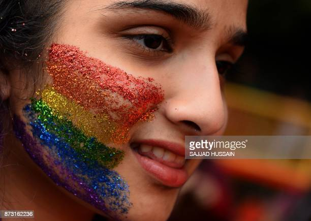 An Indian supporter of the lesbian gay bisexual transgender community takes part in a pride parade in New Delhi on November 12 2017 Hundreds of...