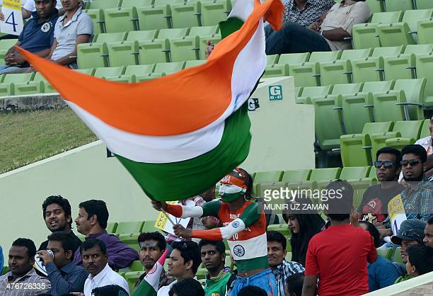 An Indian supporter waves his national flag during the ninth match of the Asia Cup oneday cricket tournament between India and Afghanistan at the...