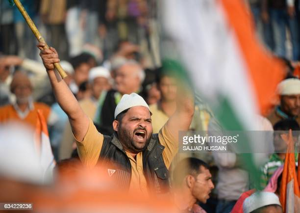 An Indian supporters of the Congress and Samajwadi political parties shouts slogans during an election rally by Congress Party leader Rahul Gandhi...