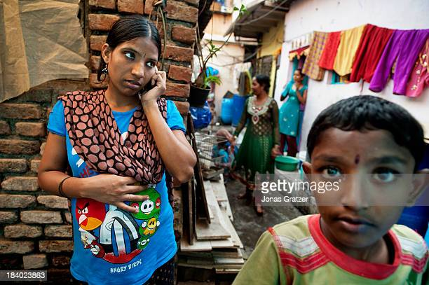 An Indian surrogate mother talks on the phone in the alley of a Mumbai ghetto A clinic in Mumbai called 'Surrogacy India' have rented a room in a...