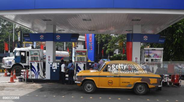 An Indian taxi driver waits at a gas station in Kolkata on June 16 2017 India is to begin revising national petrol and diesel prices daily at 6am...