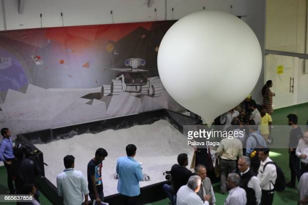 An Indian team has been simulating moon like conditions on earth to test the four wheeled moon rover by floating a helium balloon to reduce effects...