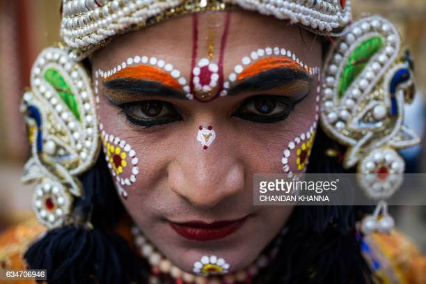 An Indian traditional dancer poses ahead of his performance at the Suraj Kund crafts fair in Faridabad on February 11 2017 / AFP PHOTO / CHANDAN...