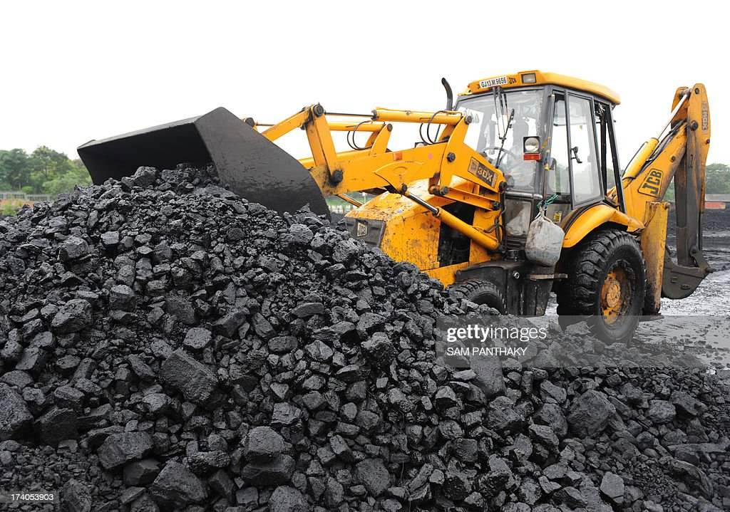 An Indian truck driver prepares to load coal onto a truck at the Kankaria Railway yard in Ahmedabad on July 20, 2013. In 1973, India nationalised its coal industry and created state-run giant Coal India. Then in 1993 it allowed private companies to mine coal for their own use when state output could not supply demand. AFP PHOTO / Sam PANTHAKY