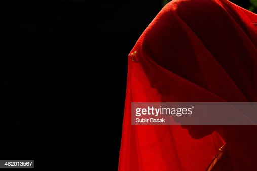 An Indian veiled woman with traditional ornaments