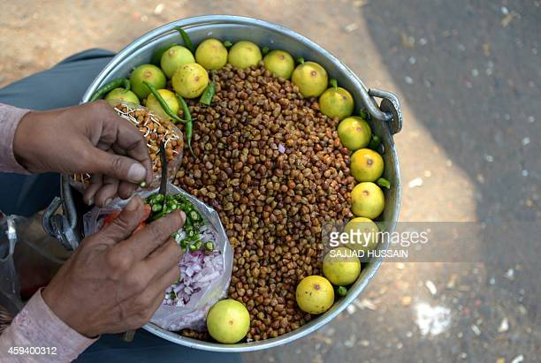 An Indian vender prepares a black garam snack on a roadside in New Delhi on November 18 2014 Indias new government declared in October that it had...