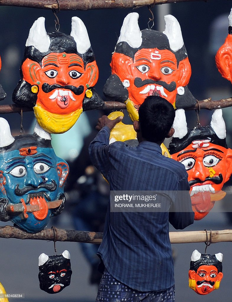 An Indian vendor arranges devil masks, believed to ward off evil if hung outside homes, at his roadside stall in Hyderabad on February 23, 2013. India's government was accused Friday of major intelligence failures after twin bicycle bombings killed 16 people, as it emerged police were warned months ago of a possible attack at the site. The near-simultaneous attacks Thursday night outside a cinema and a bus stand in Hyderabad's Dilsukh Nagar district were the first deadly bombings in India since 2011 and triggered international condemnation including from rival Pakistan. AFP PHOTO/Indranil MUKHERJEE