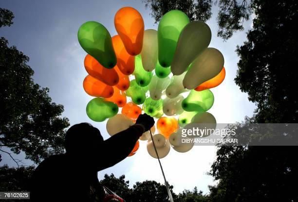 An Indian vendor displays his stock of balloons in the tricolours of the national flag on a street in Bangalore 15 August 2007 during celebrations...