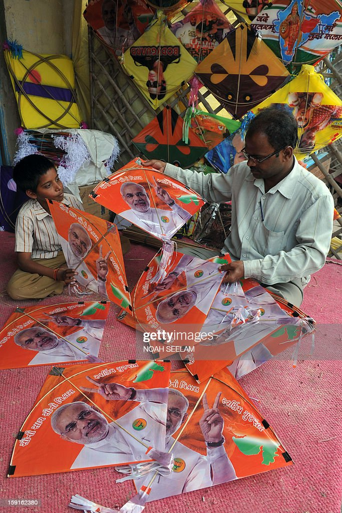 An Indian vendor displays kites printed with portraits of Gujarat state Chief Minister Narendra Modi ahead of the forthcoming Makar Sankranti kite festival in Hyderabad on January 9, 2013. The Makar Sankranti festival, which will be celebrated on January 14 this year, celebrates the beginning of the harvest season. AFP PHOTO/Noah SEELAM