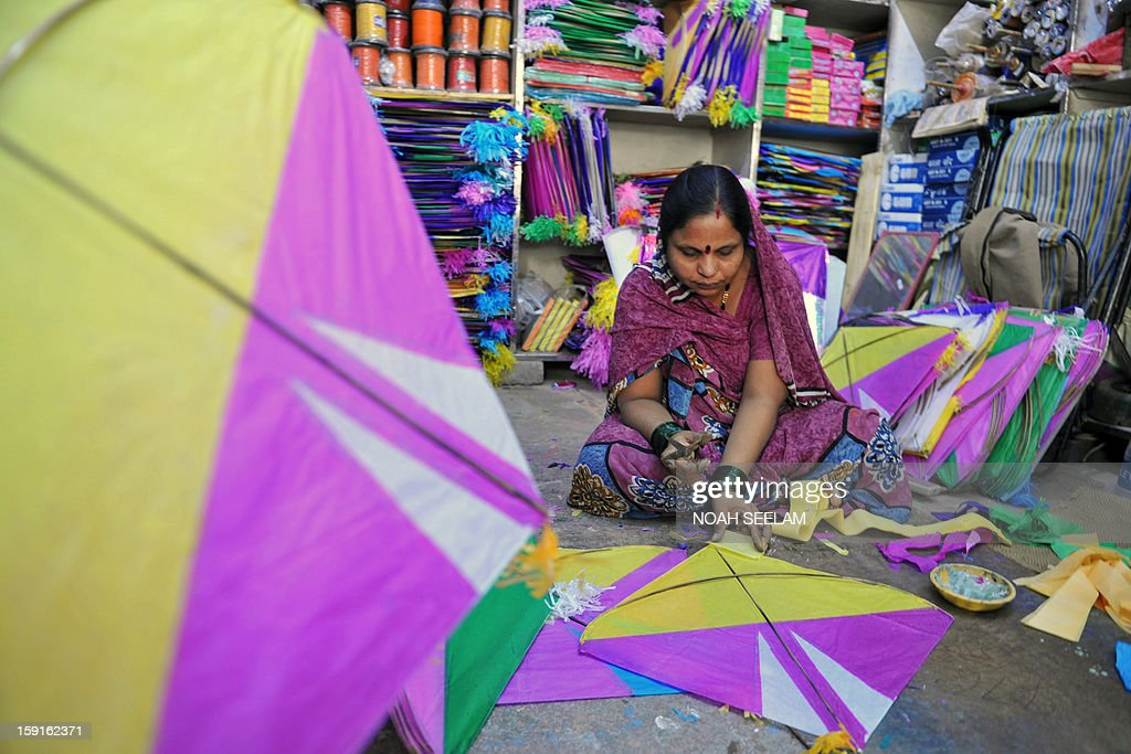 An Indian vendor makes kites in her workshop ahead of the forthcoming Makar Sankranti kite festival in Hyderabad on January 9, 2013. The Makar Sankranti festival, which will be celebrated on January 14 this year, celebrates the beginning of the harvest season. AFP PHOTO/Noah SEELAM