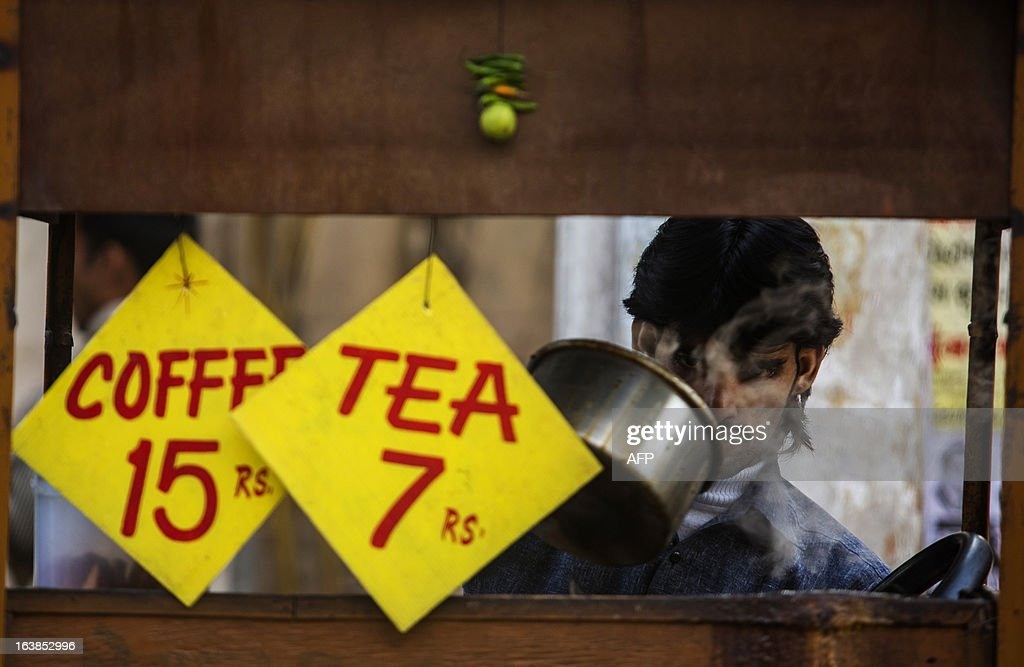 An Indian vendor makes tea in New Delhi on March 17, 2013. Indian business leaders and the government have for months been calling for lower lending rates to help the once-booming economy, forecast to see a five percent growth rate in the year to March 2013, the weakest in a decade. AFP PHOTO/ Andrew Caballero-Reynolds