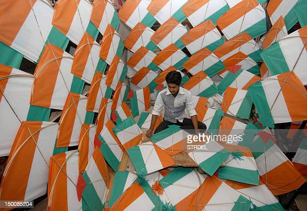 An Indian vendor makes tricolour kites ahead of the the upcoming Independence Day in Jodhpur on August 10 2012 Indian Independence Day is on August...