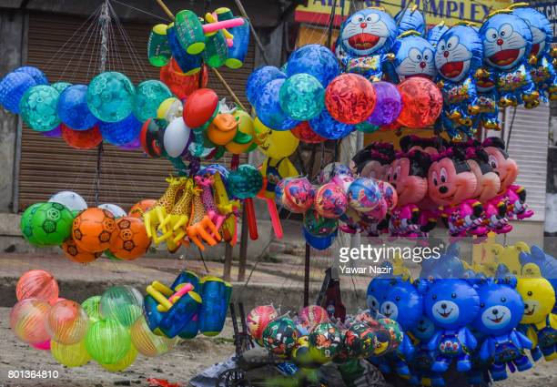An Indian vendor selling balloons as he waits for Muslim customers on Eidulfitr a festival of Muslims on June 26 2017 in Srinagar the summer capital...
