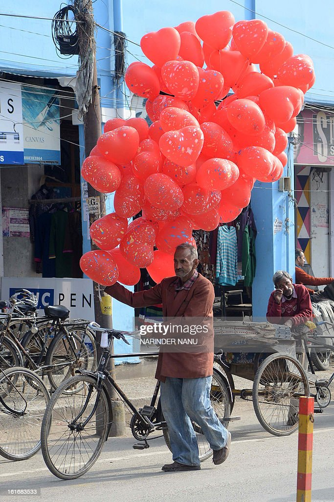 An Indian vendor sells heart-shaped balloons on the occasion of Valentine's Day in Amritsar on February 14, 2013. Hindu organizations strongly oppose Valentine's Day celebrations citing them as a cultural invasion of the conservative nation.