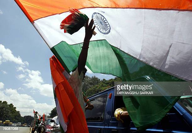 An Indian vendor sells Indian national flags to motorists and commuters on a busy city street in Bangalore 14 August 2007 The whole country prepares...