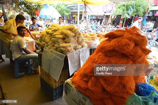 An Indian vendor sells sewaiyan before the 'Eid ulFitr' celebration in Nagaon 180km East of Guwahati Eid alFitr marks the end of the holy month of...