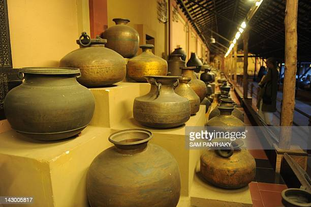 An Indian visitor admires a variety of utensils at the Vishalla Environmental Centre For Heritage of Art Architecture and Research/Veechar Utensil...