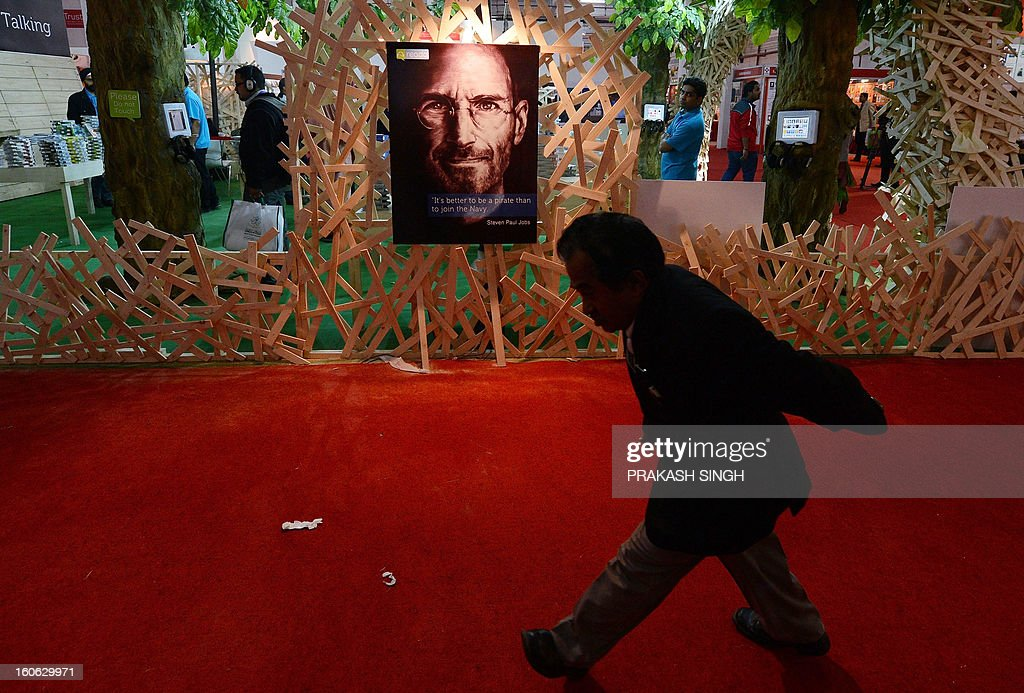 An Indian visitor passes by a poster of Steve Jobs at the Delhi World Book fair at Pragati Maidan in New Delhi on February 4, 2013. The New Delhi World Book Fair (NDWBF) held for the past 40 years is a major calendar event in the publishing world. AFP PHOTO/ Prakash SINGH