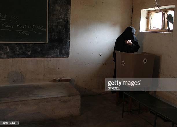 An Indian voter casts her ballot at a polling booth in Doda some 170kms east of Jammu on April 17 during national elections India is hosting its...
