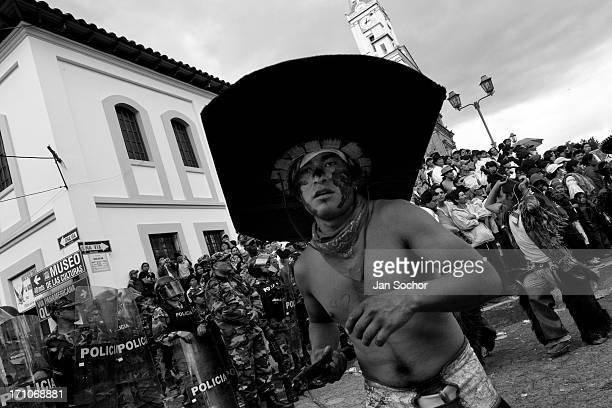 An Indian wearing a large cardboard hat dances in front of the police block during the Inti Raymi festivities on 29 June 2010 in Cotacachi Ecuador La...