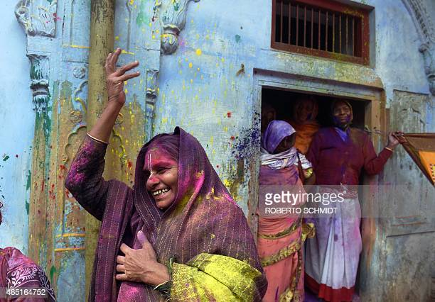 An Indian widow dances as she celebrates Holi or 'festival of colors' in Vrindavan on March 3 2015 Widows congregated on a small patio of the ashram...