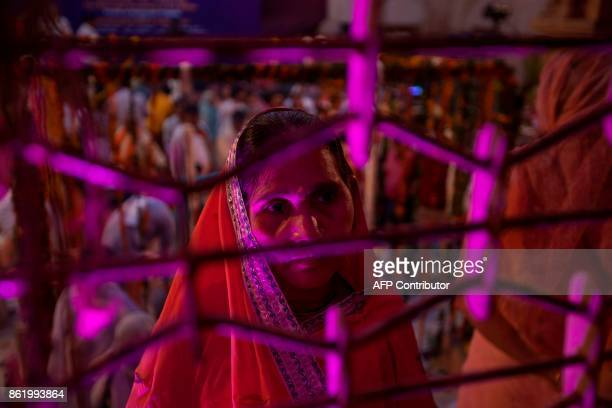 An Indian widow looks on after the wedding ceremony of Vinita Devi a former widow and Rakesh Kumar at Gopinath temple in the Vrindavan on October 16...