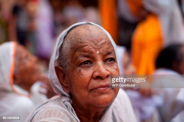 An Indian widow looks on during the wedding ceremony of Vinita Devi a former widow and Rakesh Kumar at Gopinath temple in the Vrindavan on October 16...