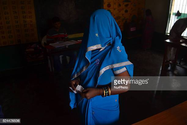 An indian woman casts her vote in a polling centre for first phase of Panchayat elections in Rampur23 kms from Allahabad on October 92015
