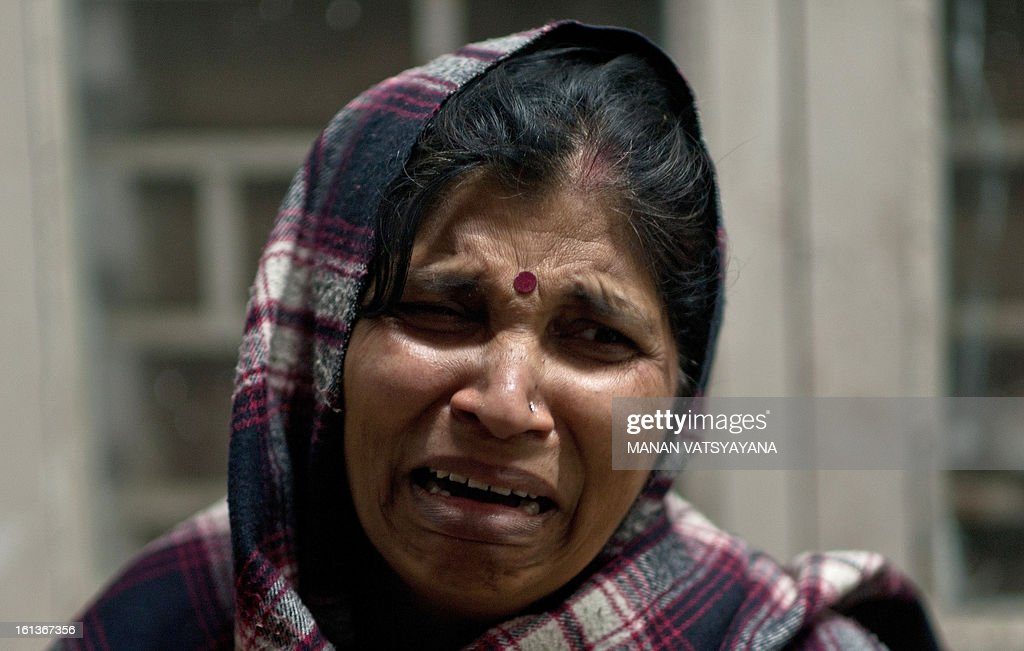 An Indian woman, caught in a stampede, reacts after not finding her relative whom she last saw at the sight of the accident at the Railway Hospital in Allahabad on February 10, 2013. At least 10 people died in a stampede as pilgrims headed home from India's giant Kumbh Mela festival, which drew a record 30 million people to the banks of the river Ganges. The lives were lost at the main railway station where 10 corpses wrapped in white sheets could be seen on a train platform several hours after the incident which occurred in the early evening. AFP PHOTO/ MANAN VATSYAYANA