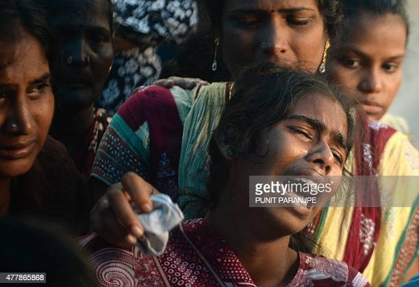 An Indian woman cries over the body of a victim of toxic homemade liquor consumption in Mumbai on June 20 2015 The death toll from India's latest...