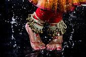 An Indian woman dancing during rain