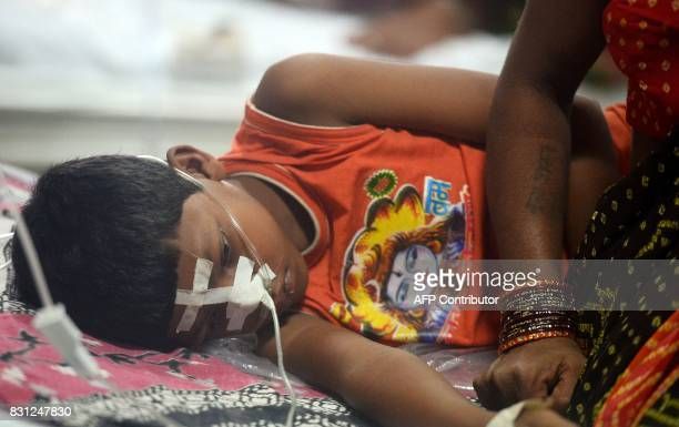 An Indian woman looks after her child at the encephalitis ward of the the Baba Raghav Das Hospital in Gorakhpur in the northern Indian state of Uttar...