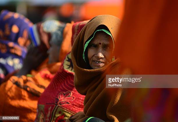 An indian woman looks on as she takes part in a programme to get free gas connection card given by Minister of state for Patrolium and natural gas Mr...